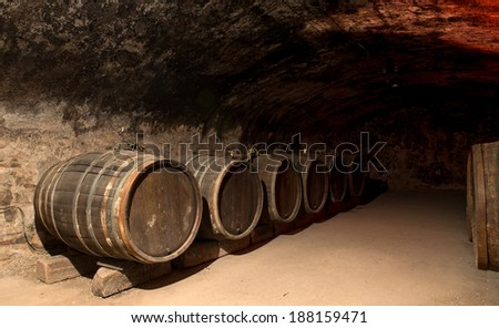 Wine barrels in a traditional cellar - stock photo