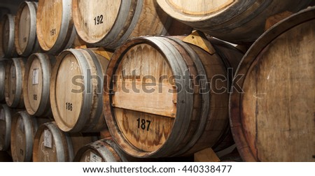 stacked oak barrels maturing red wine. Stacked Oak Barrels Maturing Red Wine. Brilliant Wine In Cellar