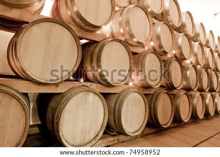 wine barrels in old wine cave - stock photo