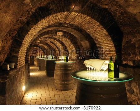 Wine barrels in the old cellar of the winery. - stock photo