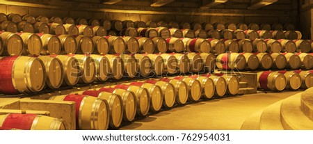 stacked oak wine barrels. Wine Barrels In The Winery. Stacked Oak Barrels. Production. Stainless Steel Industrial