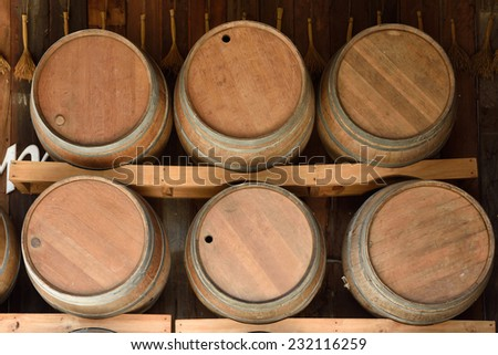Wine barrels in wine-vaults in orde - stock photo