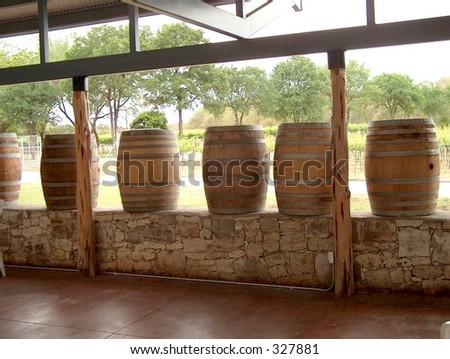 Wine barrels on a deck - stock photo