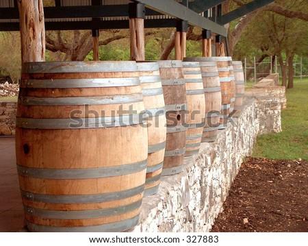 Wine barrels on a wall - stock photo
