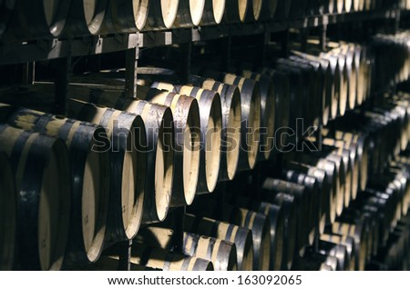 Wine barrels stacked in cellar
