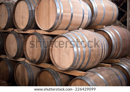 Wine barrels stacked in the old cellar of the winery