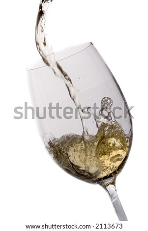Wine being poured in a glass