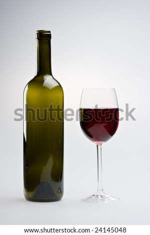 wine bottle and a glass of red - stock photo