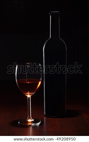 Wine bottle and a half full glass