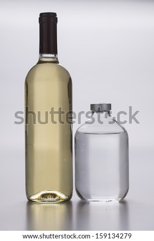 wine bottle and ampule on white