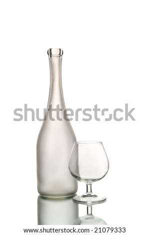 Wine bottle and glass isolated on white - stock photo