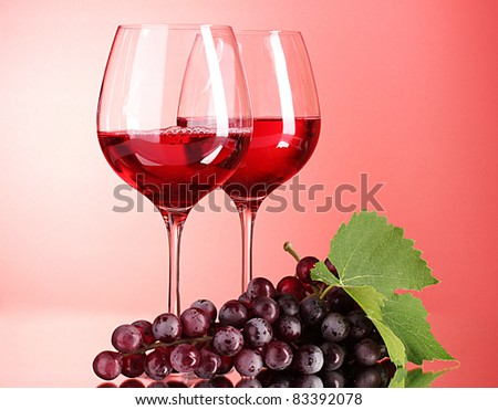 Wine bottle and glass on red background