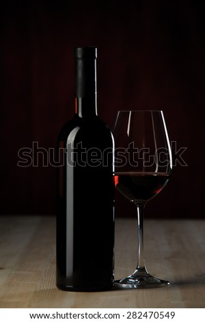 wine bottle and glass on the wooden table