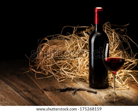 wine bottle and glass with red wine - stock photo
