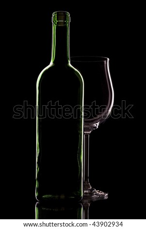 Wine bottle and glasses, a black background. - stock photo