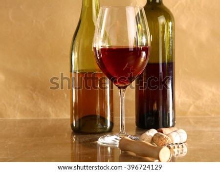 wine bottle and wine glass on a glass table