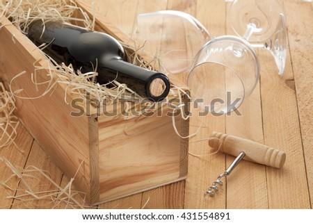 Wine bottle and wine glass / red wine bottle/ corkscrew/ wine concept  - stock photo