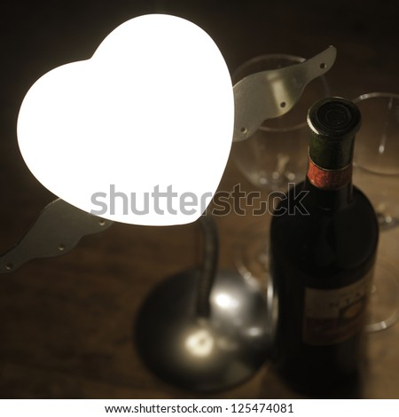 wine bottle and wine glasses on wooden table - stock photo