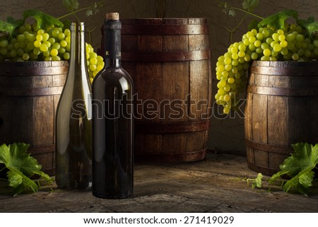 wine bottle and wooden barrel - stock photo