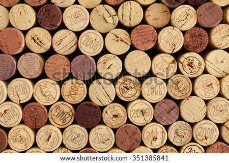 Wine bottle cork tops arranged tightly each other. Closeup