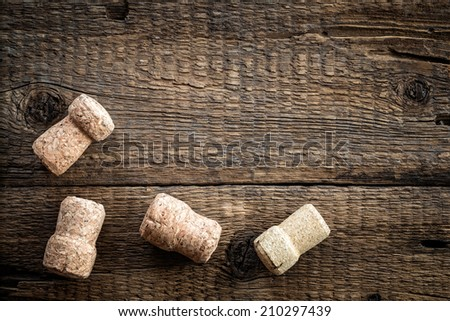 Wine bottle corks on the wooden background - stock photo