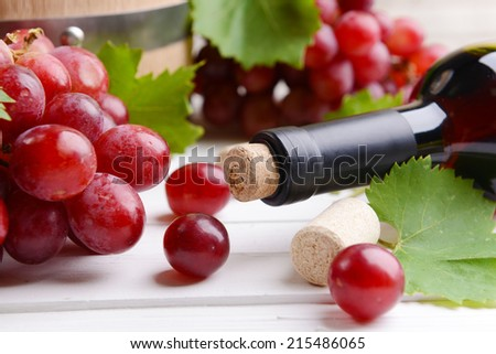 Wine bottle corks with grapes on table close-up - stock photo
