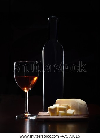 Wine bottle glass and some cheese - stock photo