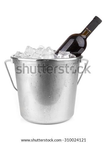 Wine bottle in ice isolated on white background  - stock photo