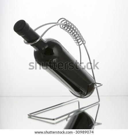 wine bottle in wine holder - stock photo
