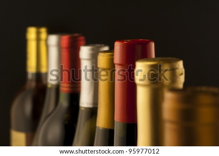 Wine bottle necks with limited depth of field - stock photo