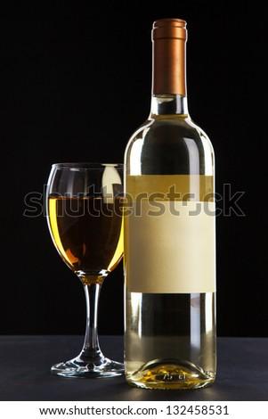 Wine bottle on black background - stock photo