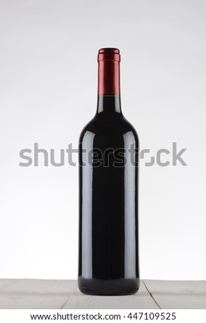 Wine bottle on wooden table