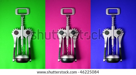Wine bottle opener on different coloured backgrounds - stock photo
