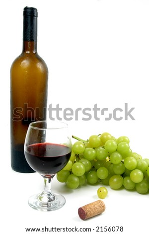 Wine bottle with a glass and grapes over white background.