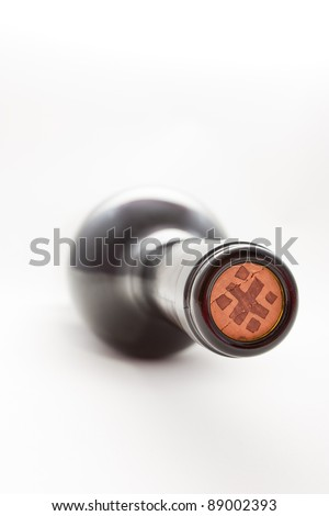 Wine bottle with cork over white - stock photo