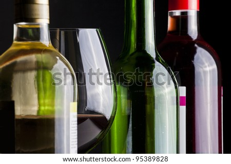 Wine bottles and glass - stock photo