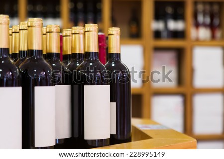 wine bottles at the wine store - stock photo