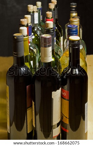 Wine bottles, empty and closed cap standing in several rows.