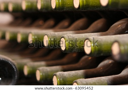 Wine bottles from cellar - close up