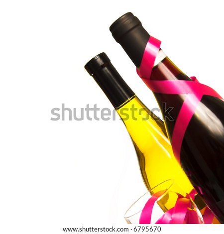 Wine Bottles, Glass and Ribbons on a Plain White Background - stock photo