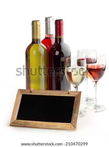 wine bottles, glasses and blackboard on white background - stock photo