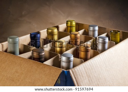 Wine bottles in a cardboard box ready to bring home - stock photo