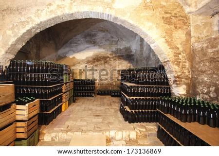 wine bottles in the cellar - stock photo