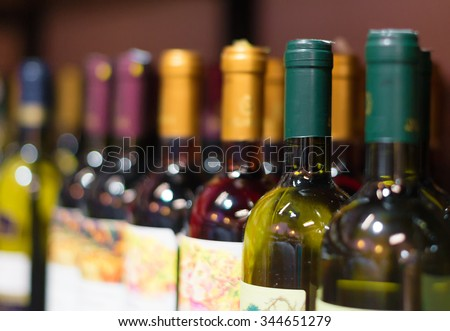 Wine bottles in the wine store. - stock photo