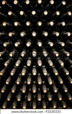 wine bottles in wine cellar - stock photo