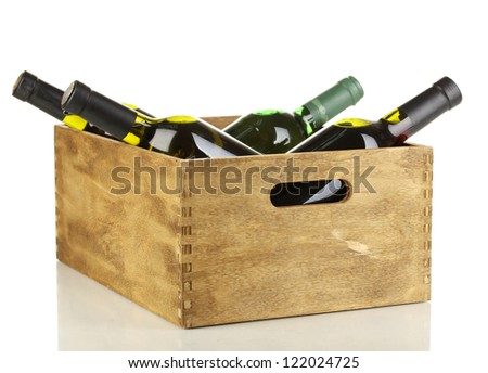 Wine bottles in wooden box isolated on white - stock photo