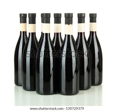 Wine bottles isolated on white - stock photo