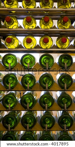 Wine bottles on a Vertical rack - stock photo