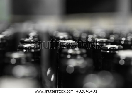 wine bottles on the conveyor, production of wine