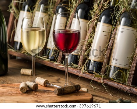 Wine bottles on the wooden shelf. - stock photo